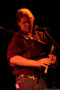 EJ playing smallpipes